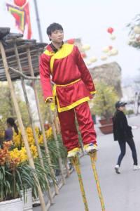 New Year Festival: Stilt walker