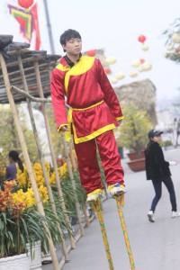 New Year Festival: Stilt walker