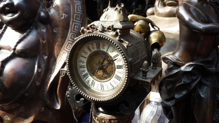 An intricate clock at Hanoi Antique fair