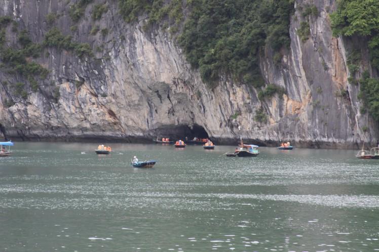Kayak and boat in Halong Bay Vietnam